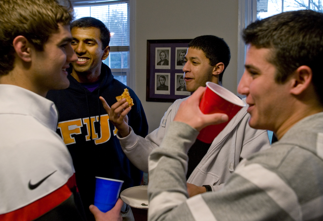 WASHINGTON, DC - JANUARY 28: Phi Gamma Delta VP Garish Sankar (L) in Fiji sweats at the Fiji House meet-and-greet on January 28, 2012.  Phi Gamma Delta (Fiji) at the University of Maryland offered pizza and games as they showed off their fraternity house during 4-7pm. (Photo by Tracy A. Woodward/The Washington Post)