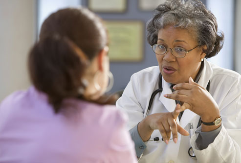 getty_rf_photo_of_female_doctor_talking_to_patient