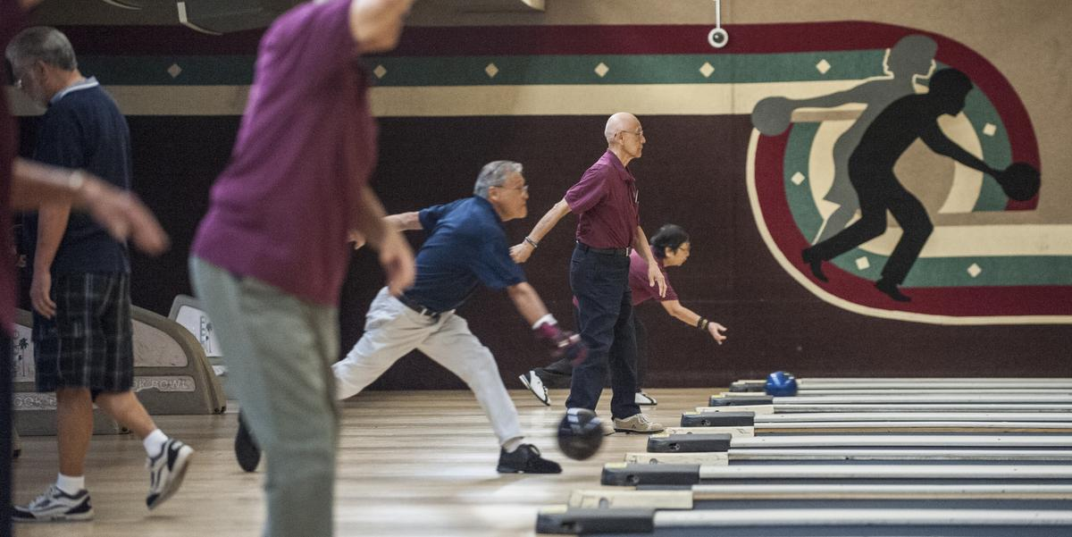 Members of the Nikkei Seniors toss their balls down the lanes early one morning at the Linbrook Bowling Center in Anaheim.    ///ADDITIONAL INFORMATION:  BowlingAlleys Ð 10/15/15 Ð MARK RIGHTMIRE, THE ORANGE COUNTY REGISTER