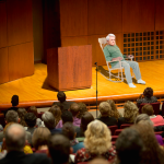 Newt Gingrich Sits In Rocking Chair For Entire Lecture