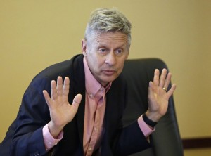 FILE - In this May 18, 2016 file photo, Libertarian presidential candidate, former New Mexico Gov. Gary Johnson speaks with legislators at the Utah State Capitol in Salt Lake City. The day after political heavyweight Mitt Romney name-dropped him on Twitter, the former New Mexico governor seemed to reveal a hole in his foreign-affairs knowledge when he was befuddled by an otherwise routine question about the Syrian city of Aleppo. (AP Photo/Rick Bowmer, File)